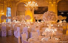 Stoneblossom wedding at Rosecliff, Newport RI. I'm not too fond of the chair covers, but I do fancy the lush centerpieces.