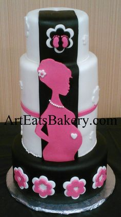 Pink, black and white chic baby shower cake with flowers, baby feet and mom with pearls