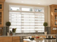 "Overtones Sheer Shades Overtones Sheer Shades can be motorized with Simplicity Radio Controlled Motors. Overtones incorporate dual layers of alternating 3"" semi-opaque and 2"" sheer woven fabric vanes."