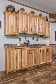 Commodore Homes of Pennsylvania Astro Ranch - - 3A255A | Hickory Cabinets in the eat-in kitchen.