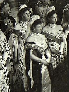Empress Maria Feodorovna (in dark dress) with her two daughters (sisters of Nicholas II): Xenia (right) and Olga (behind the Empress). All three are wearing diamond tiaras and sashes of the Saint Andrew Order. Empress Maria is also wearing a chain of the Order.