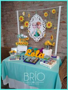 Don't you just love the backdrop of this Frozen Fever birthday party? Love the hanging sunflowers!! See more party ideas and share yours at CatchMyParty.com