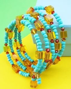 """This """"Block of Crystals"""" Wrap Bracelet is strung on stainless steel memory wire and it wraps around your wrist five times in Yellow Cubes, Red Magma"""