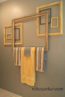 Minus the towels. Example of frames that could be hung w/fishing wire on backdrop. White, black, silver or a pop of color?