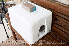 DIY heated cat shelter (styrofoam cooler) for a stray who won't come in from the cold.