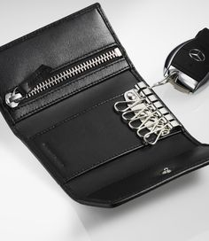 Black key wallet in lambskin with diamond-pattern topstitching. Key Wallet, The Black Keys, Diamond Pattern, Mercedes Benz, Zip Around Wallet, Card Holder, Chain, Rolodex, Necklaces