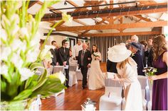bride and father walk down aisle in the brindley Room in Castlefield rooms