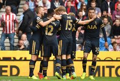 Heung-min is congratulated by his team-mates after giving his side the lead away from home in the Premier League affair