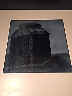This is a custom engraved 12x12 granite tile with a photo of a local vintage grain silo. We can also engrave your photos onto tiles for an even greater