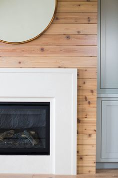 solutions for a raised fire box  Natural Tongue & Groove Wood Fireplace :: Ashley Winn Design