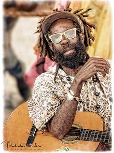 The Reggae Singer: Meetin the Reggae Singer.  Strumming out some great tunes in the Caribbean Islands. PortraitStreet PhotographyPeopleGuitarStreetMusicianManMaleNorth AmericaCaribbeanJamaicaLifestyleMenMusical InstrumentsInstrumentsStreet PerformerWorkingReggaeMalesStreetscapeJamaicanCaribbean IslandsProfessionsRolesGuitar Player