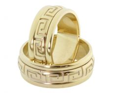 18k gold wedding bands with the Greek symbol for eternity.