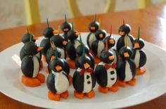 For those of you who would like to bring penguins to your holiday table, here are some adorable hors d'oeuvres made from olives, cream cheese, carrot slices, and red pepper for the jaunty bow ties. Description from fossilpenguins.wordpress.com. I searched for this on bing.com/images