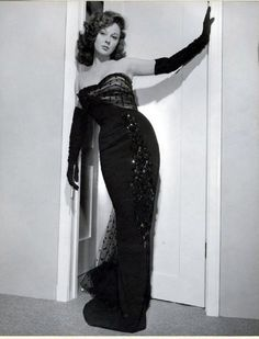 long black gloves and a fancy dress- Susan Hayward