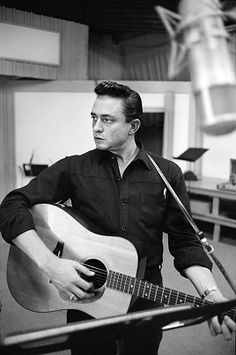 """"""" Johnny Cash NYC, 1959 This shot of Johnny Cash at the Columbia Records studio in October 1959 gives us a glimpse of the inner workings of the man in black, doing his job away from the limelight of an audience. There's a ball-point pen. Young Johnny Cash, Johnny Cash June Carter, Johnny And June, Country Music Artists, Country Music Stars, Country Singers, Country Musicians, Rock And Roll, John Cash"""