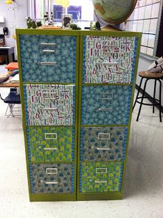Spray paint file cabinets. Then use scrapbook paper and spray adhesive to cover front of each drawer.