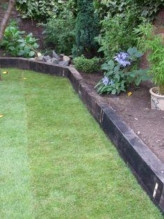 Garden Design Using Railway Sleepers sunken patio with tiered gardens | railway sleepers garden