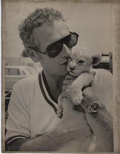 Paul Newman holding a lion cub.