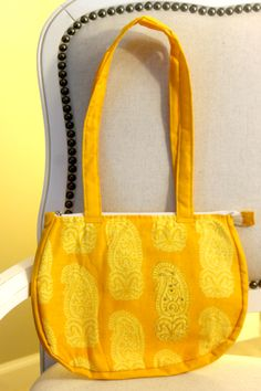 Handmade fashionable purses and bags. Dhara Bags are handmade by a female tailor workshop in India, and proceeds from sales go to providing nutritious meals to the homeless. Available here- http://www.dharabags.com. Just like the bright Indian summer sun, this bag shines a bright yellow with heritage Indian print on cotton.