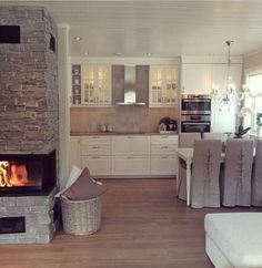Haus Country kitchen-style white with brown worktop fireplace with stone wall Country style kitchen- Eat In Kitchen, Country Kitchen, Kitchen Decor, Kitchen White, Kitchen Living, Kitchen Stove, Living Room, Living Area, Kitchen Ideas