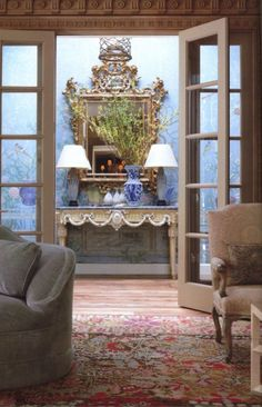 Beautiful mirror and table, oriental rug, and blue and white porcelain - Michael Smith from Town and Country