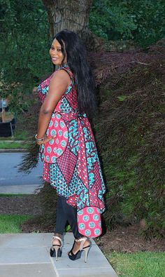 The sexy Miu Tunic top has a wrap front synched with a belt. Try this african ankara tunic with blue, black or white denim. African Print Skirt, African Print Clothing, African Print Dresses, African Dress, African Tops For Women, African Jumpsuit, Maxi Dress With Slit, White Denim, African Fashion