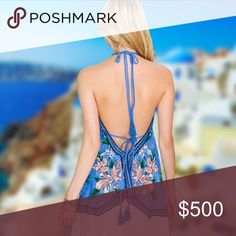 """✨Its New✨Blue V-Halter neck with tassel ✨It's New✨Blue V-halter neck with tassel   A bold print and free-flowing fit create an ultrafeminine and flattering look. Open back.  * 100% rayon. Approx. measurements 19"""" in length (Size S) Available in white (M) Tops Blouses"""