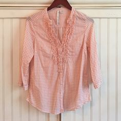 Lauren Conrad Button-Up Top Lauren Conrad button-up shirt in light pinkish-peach color and white plaid with ruffle detail on front and 3/4 sleeves. Button on bottom of sleeves or you can roll them up for a more laid-back look. 100% cotton. Only worn once and in excellent condition. Size: Small LC Lauren Conrad Tops Button Down Shirts