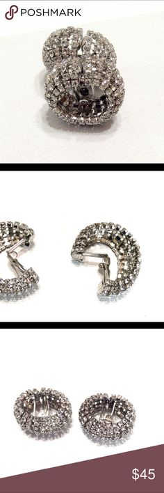 Clear Rhinestone HUGGIE HOOP Clip On Earrings VIntage Clear Rhinestone HUGGIE HOOP Unique Clip On Earrings HIGH QUALITY Very cool Vintage Rhinestone HIGH QUALITY Huggie Clip earrings with a unique clip mechanism, substantial, high quality and very comfortable, I noticed a few light pink rhinestones interspersed amongst the Clear Rhinestones. They look original to the earrings. Earrings Measure approximately 1-1/8th inches. See Photos with Ruler. Vintage Jewelry Earrings