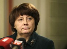 Newly appointed Prime Minister Laimdota Straujuma listens to a question during a news conference in Riga January 6, 2014.