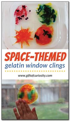 Space-themed gelatin window clings are an awesome art project for kids to do while learning about planets and the solar system! || Gift of Curiosity