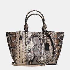 A highly textured mix of richly colored snake-embossed leathers gives the structured Crosby Carryall a luxe update. The design is dressed up with richly plated signature hardware, including a turnlock zipper pull that locks with a twist for security.