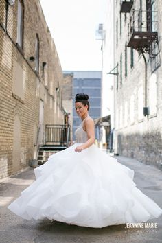 With a voluminous skirt and a beaded bodice, this gorgeous wedding dress will make you feel like a modern day princess. | Photo by Jeannine Marie Photography