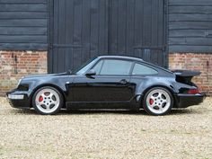 Porsche 911 Turbo 3.6 Bad Boys, shiny dick with 2 chairs in it.