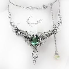 LIRVILMARH - silver and green amethyst by LUNARIEEN...I'd never be able to afford it, but it's gorgeous