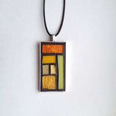 New for 2018! Bold stained glass mosaic pendants in geometric designs. Wearable art that makes a statement.
