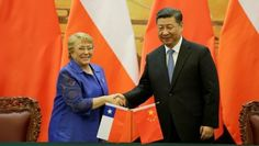 Chilean President Michelle Bachelet L And Chinese President Xi Jinping Attend A Signing Ceremony