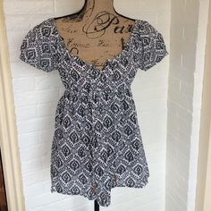 Gap Babydoll Peasant Top 100% cotton. Stretchy waist band. The rest of the shirt is not stretch. Button down to waist band with wooden looking buttons. Gently used. Excellent condition. GAP Tops Blouses