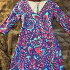 Reel me in Clarke dress Terry cloth on the inside. Worn once but it a little too big. I don't remember what the print is called but it is a 2014/2015 print Lilly Pulitzer Dresses Long Sleeve