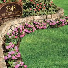 Stone Wall Border. Looks real but it's UV resistant plastic.  I like the look of this!