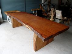 solid slab reclaimed rosewood 10 seat dining table. Great for a huge family.
