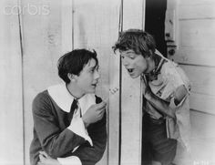 Actors Jack Pickford and Robert Gordon in the 1917 movie Tom Sawyer. Pickford plays Tom Sawyer and Gordon his friend Huckleberry Finn in the film.