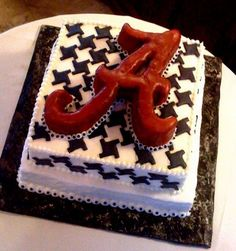 Houndstooth Alabama cake!  Football Birthday cake photos. The best football cakes on Pinterest and the best football cakes on the web! Football cake ideas such as Football Stadium cakes, football field cakes, football helmet cakes, and football logo cakes. #football #cakes #gifts