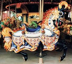 The lead horse or King Horse, the most elaborately carved horse on the Euro Disney Carousel outside Paris. It is one of 17 horses designed and made for Euro Disney by Joe Leonard