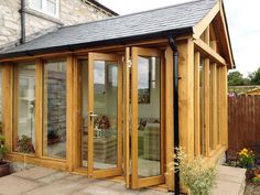 Vufold aluminium and timber external bi-fold doors and come in an array of sizes from to and of 2 to 6 door configuration all ready to install. Wooden Cottage, Wooden Barn, Barn Windows, Windows And Doors, Bifold Interior Doors, External Bifold Doors, Oak Framed Extensions, Conservatory Roof, Garden Room Extensions