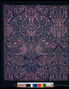 Dove and Rose Furnishing Fabric made of Woven silk and wool double cloth. This repeating pattern of flowers and vegetation was designed by William Morris in 1879 and woven by Alexander Morton & Company for Morris and Company. Morris was the artist and designer who was the greatest single influence on the Arts and Crafts movement and the most successful textile designer and manufacturer of his day. Morris revived the craft of block printing and vegetable dyeing and in his own home he set up…