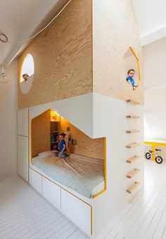 A house in the house - a children's room can easily be both practical, styled and filled with creativity and play at one and the same time. Beds and storage have been transformed into a creative house with room for it all.