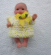 """Simple dress and jumper pattern in double knit yarn for a Berenguer or similar 5"""" baby doll."""