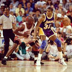Magic Johnson posting up Michael Jordan
