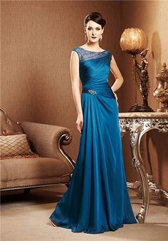 A-line Amber Satin Chiffon gown with asymmetrical waistline, lace bodice and cap sleeves. Petite Siz